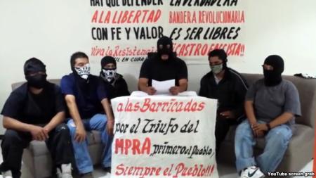 Encapuchados financiados por el DDC que ocuparon violentamente las oficinas de PL en México.