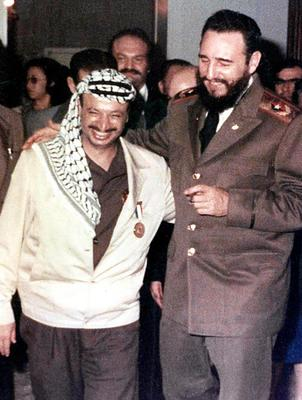 Palestinian leader Yasser Arafat, left, with Fidel Castro.